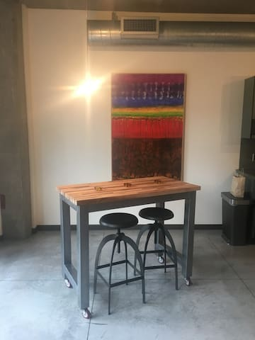 modular desk/dining space. original art throughout.