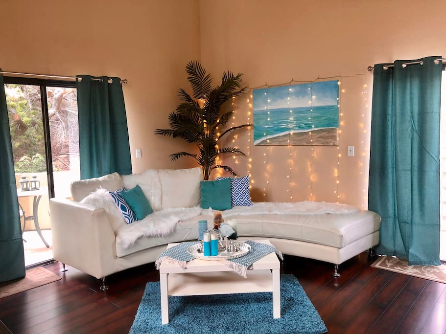 We updated the brown sofa sectional for a fresh white semi circle sofa and an aqua colored beach theme in living room.  2 foldable memory foam mattresses are available for extra guests to sleep (2 in queen bed, 2 on memory foam = 4 guests total) .