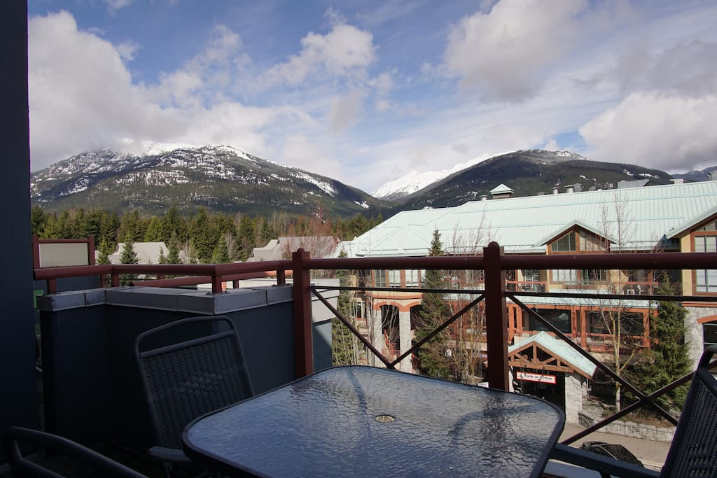 Enjoy views of the surrounding mountains from the large deck