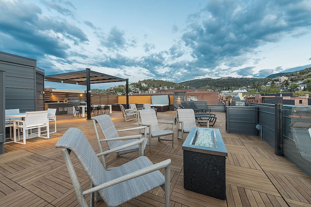 Enjoy the Rooftop Deck with Outdoor Kitchen, Hot Tub, Fire Pit, and Sitting Area