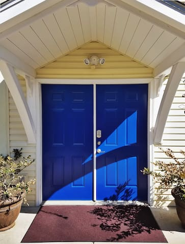 Drive down and park on your own driveway right next to the Blue Doors.  This is your entrance into the apartment suite.  Park right here, steps from the entrance - which makes unloading and reloading the car a simple matter.