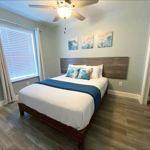 One of 2 queen bedrooms