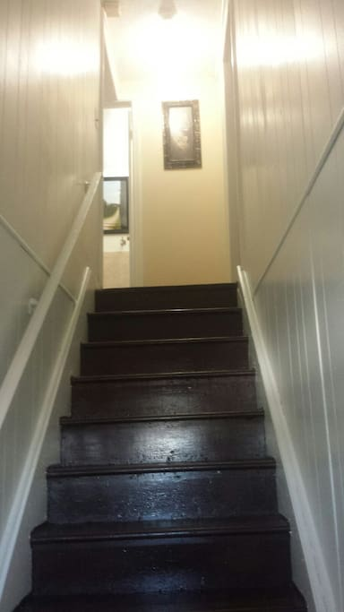 Stairway leading to the rooms upstairs.
