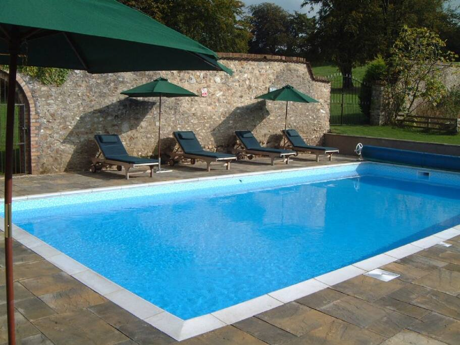 The pool in the walled garden is a super sun trap
