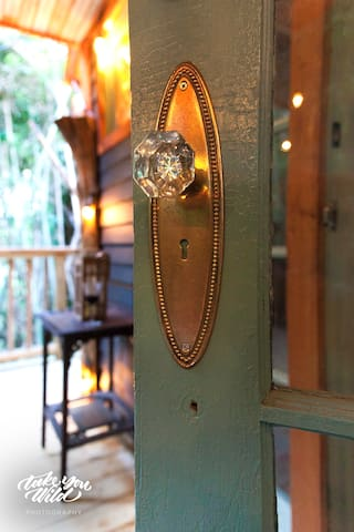 Lindsay Appel's shot of our antique treehouse brass hardware on the front door. With a glimpse into the jewel box.