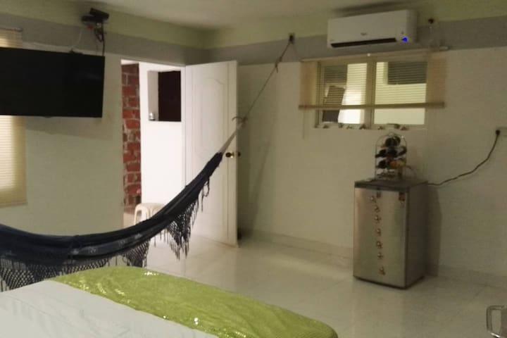 Habitación Suite con baño privado, Frigobar, Tv