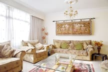 Living room: newly furnished living room with big seating area, LCD TV, air conditioned