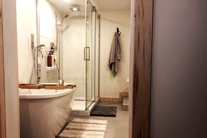 New bathroom with big shower and soaker tub to relax in.