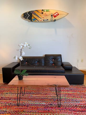 Designer sofa in the living room. Coffee table handmade by the owner :)