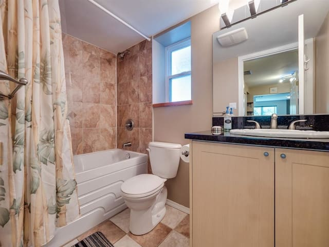 Bathroom with large soaker tub.  Big beautiful sink with granite counter top and huge mirror.