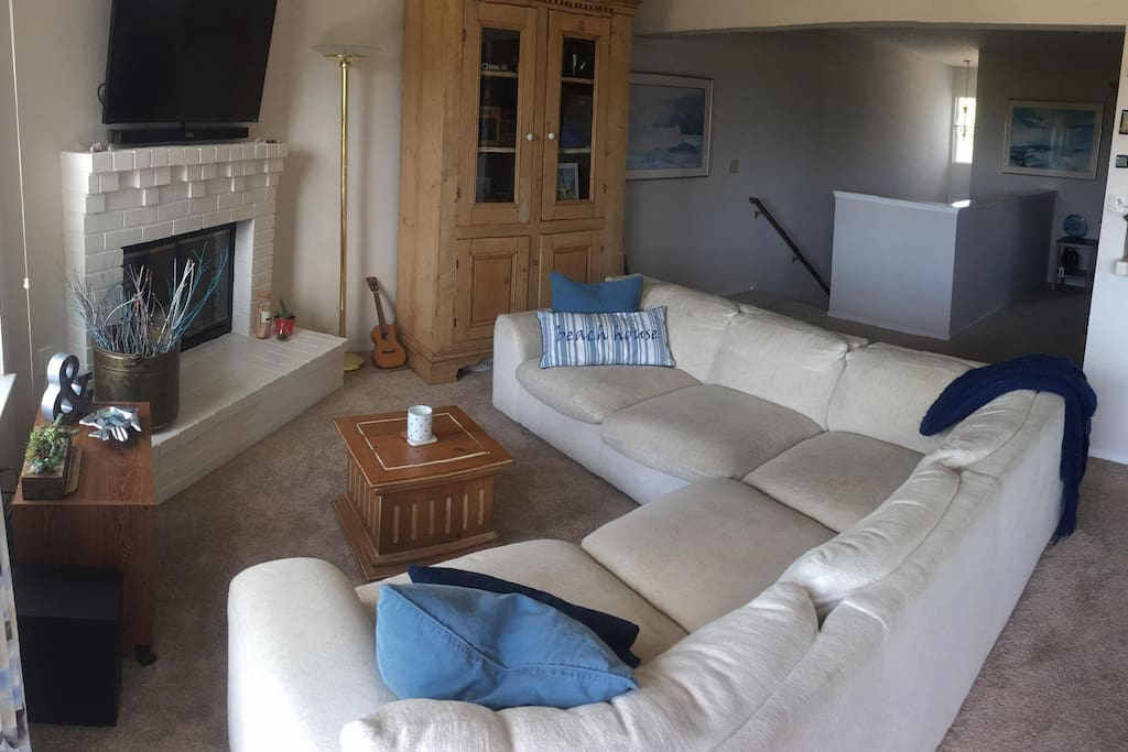 Here is another picture of our living room.  Our guest rooms are down the staircase, when you come up you will see this and the kitchen on your left.