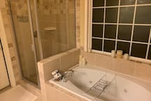 Master on-suite w/shower and garden jet tub.
