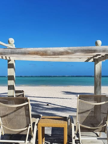 Beach Club, 10 USD includes transport (10 mins), non motorized water sports, beach chairs, sodas, frozens, water and beer.