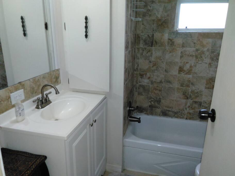 Newer renovated & updated ceramic tile bathroom.