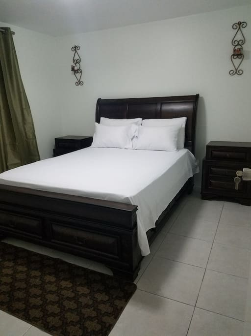 queen size bed with two night tables all together a room 12 drawer space