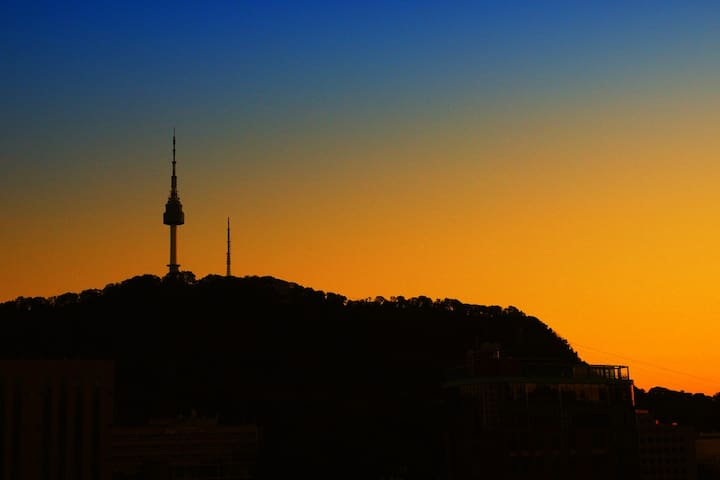 Open the window! you can see beautiful sunset of the namsan tower.