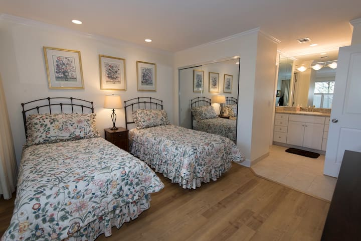 Second bedroom has twin beds and is adjacent to the second bathroom.