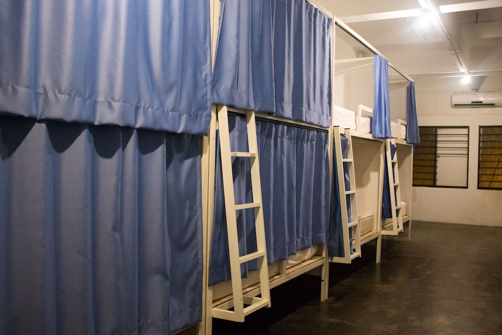 PRIVATE CURTAINED BEDS WITH LIGHTS AND AIRCON