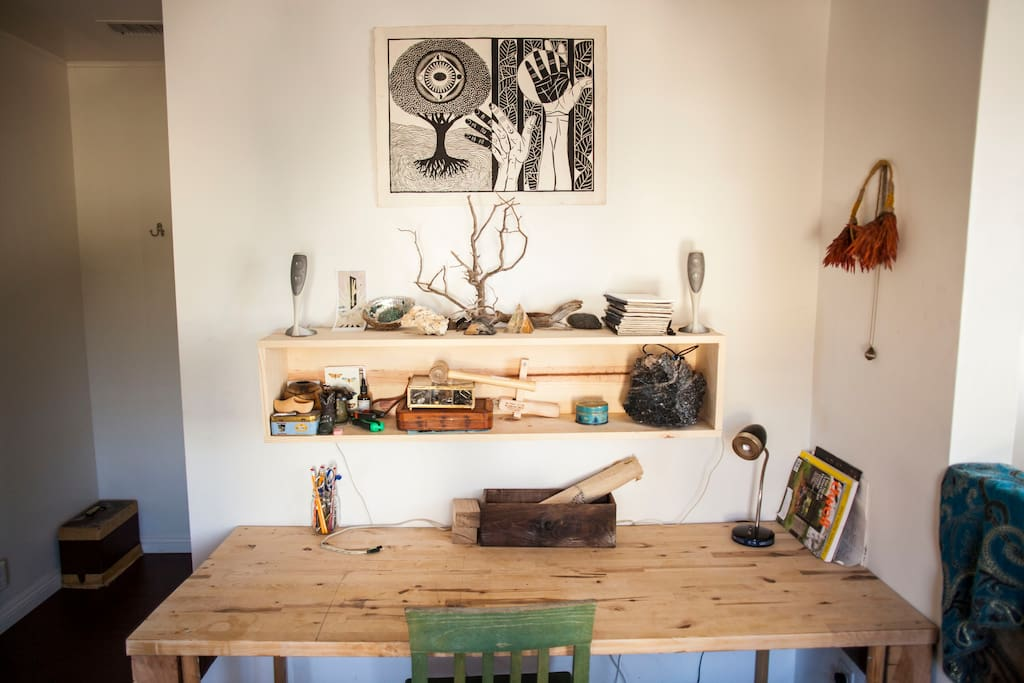 Great workspace with a natural wood desk.
