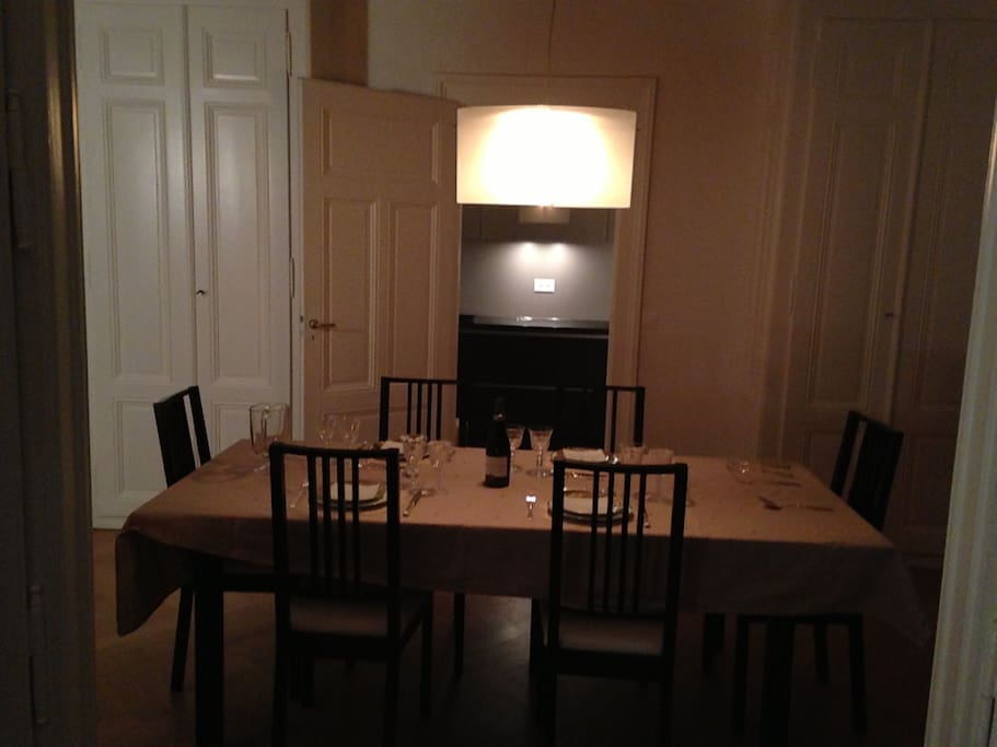 Dining room and kitchen behind