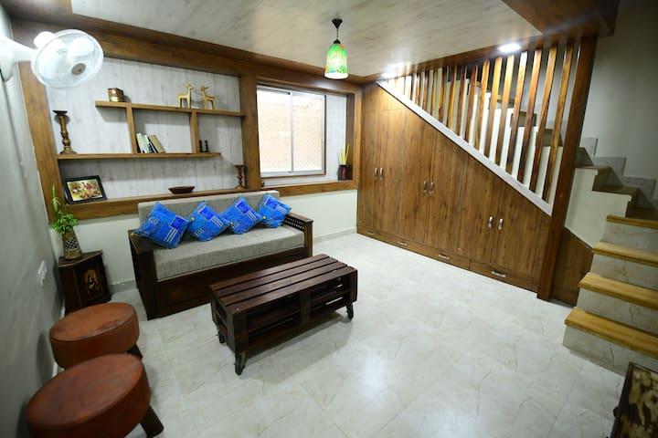 Lavish sofa cum bed in lower part of duplex room
