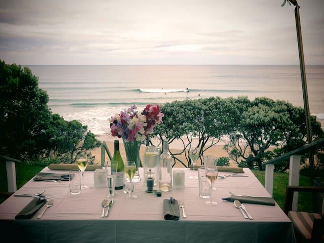 Absolute beach front Wainui Beach