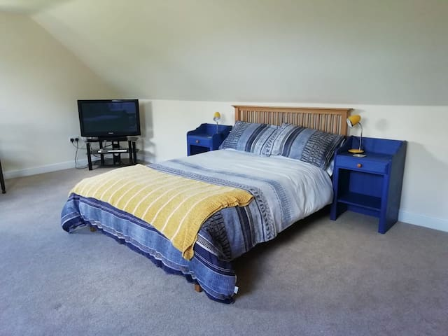 King Size Bed in large self contained studio