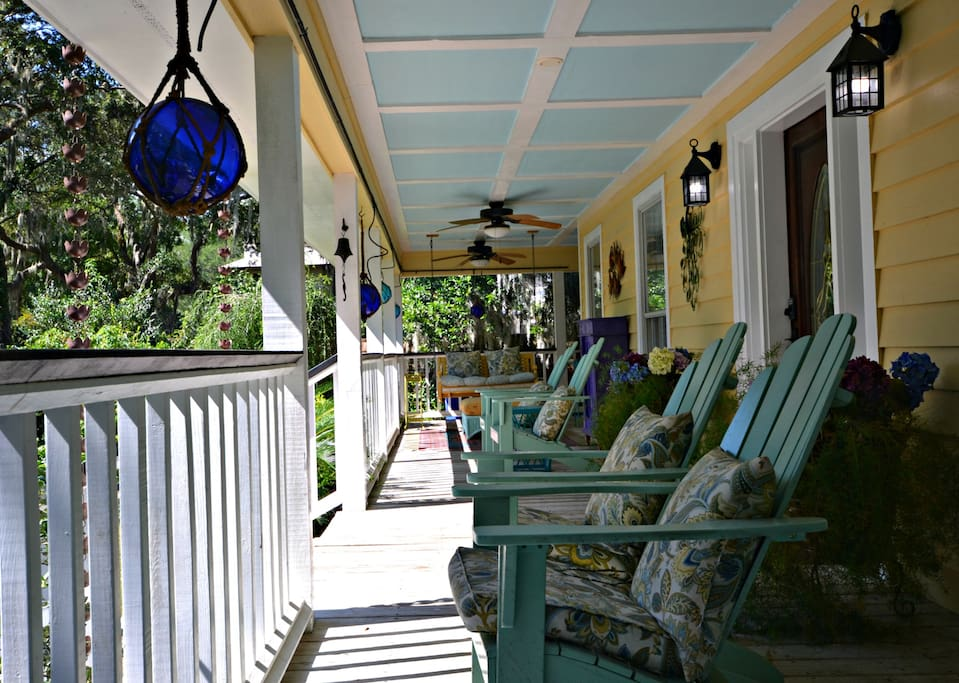 Front Wrap around porch with plenty of seating and a porch bench too.