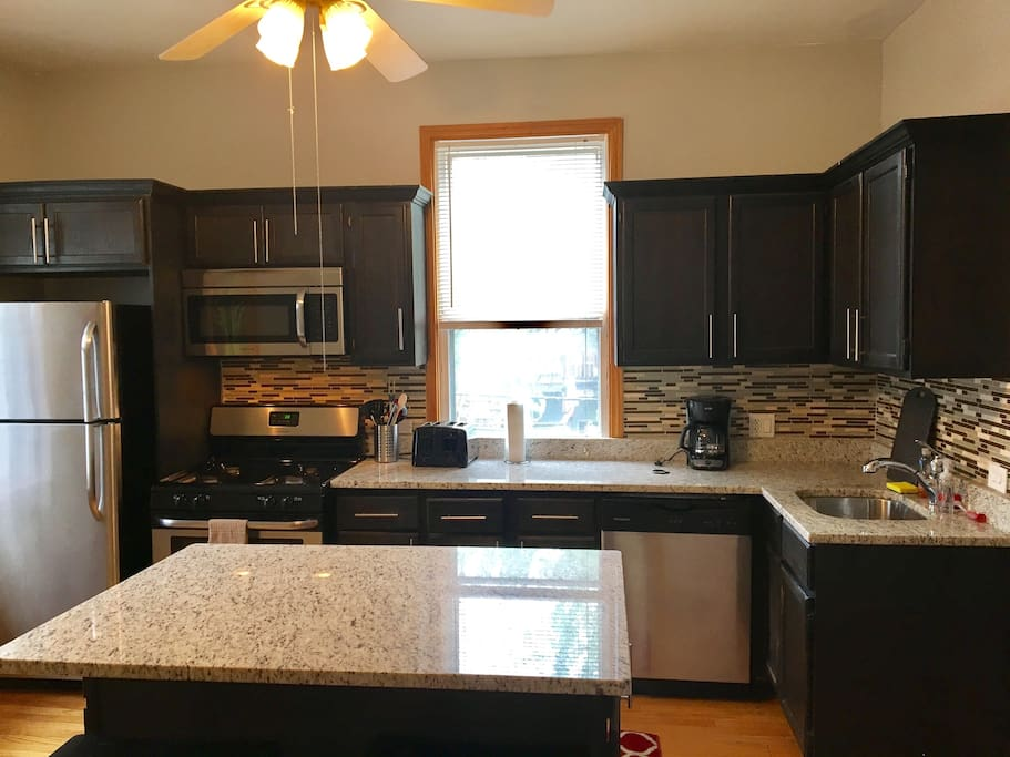 Large kitchen with cookware and dining ware (lower level)