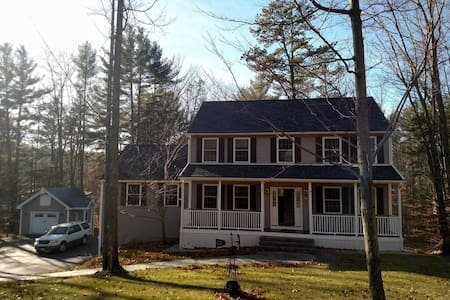 """Rent this beautiful home located just minutes from downtown North Conway. This home features 4 bedrooms and 3 bathrooms, gas fireplace, 65 """" wall mounted flatscreen tv and Brazillian cherry floors opens to the spacious eat-in kitchen."""