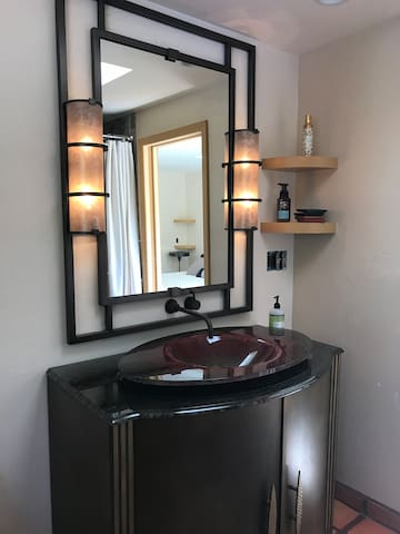 Hand made. Vanity and sink by an international artist. Wait until you see it in person.  If you like beautiful glass you will love this piece.