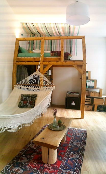 Unique studio with a sturdy, handmade loft bed and a lovely hammock, guaranteed to make you feel instantly at home.
