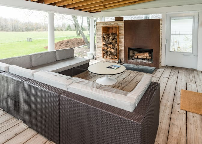 """""""The screened-in porch is fantastic, a favorite spot ... open to the air, overlooking the neighboring field..."""""""