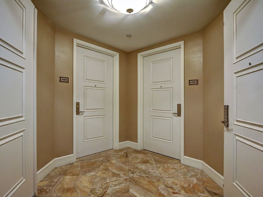 Foyer that connects Jr. Suite & 1 bedroom suite.  Both units share a private entrance.