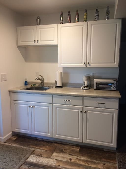 Coffee and tea provided in the kitchenette with mini coffee maker, toaster oven, mini fridge and microwave. Cabinets are stocked with dishes, cups and silverware for your convenience. Paper towel and dishwashing supplies are provided.