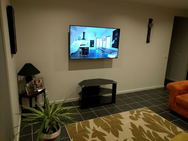 Shared living area with large screen TV and Netflix access