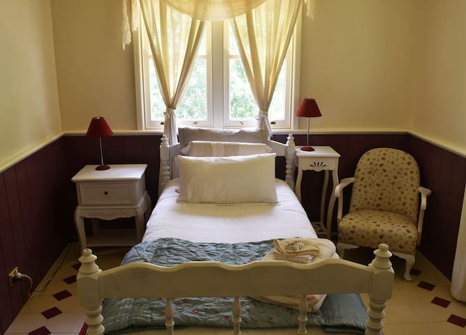 The single room is sweet and airy