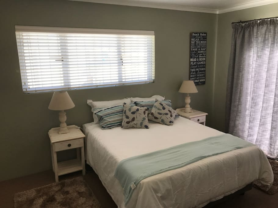 Bedroom with Queen bed, large closets and doors on to shared pool area
