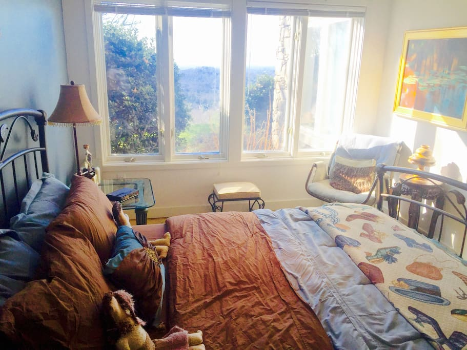 Bedroom with full amenities and a great view of the surrounding mountains.