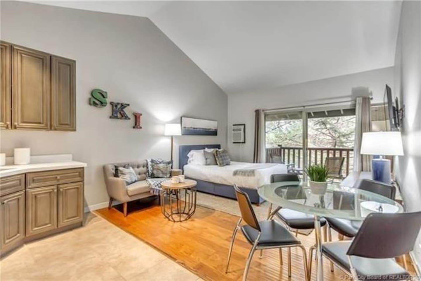 Clean, comfortable studio condo with a large vaulted ceiling.