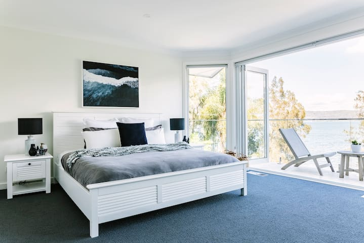 Master bedroom with balcony and ensuite