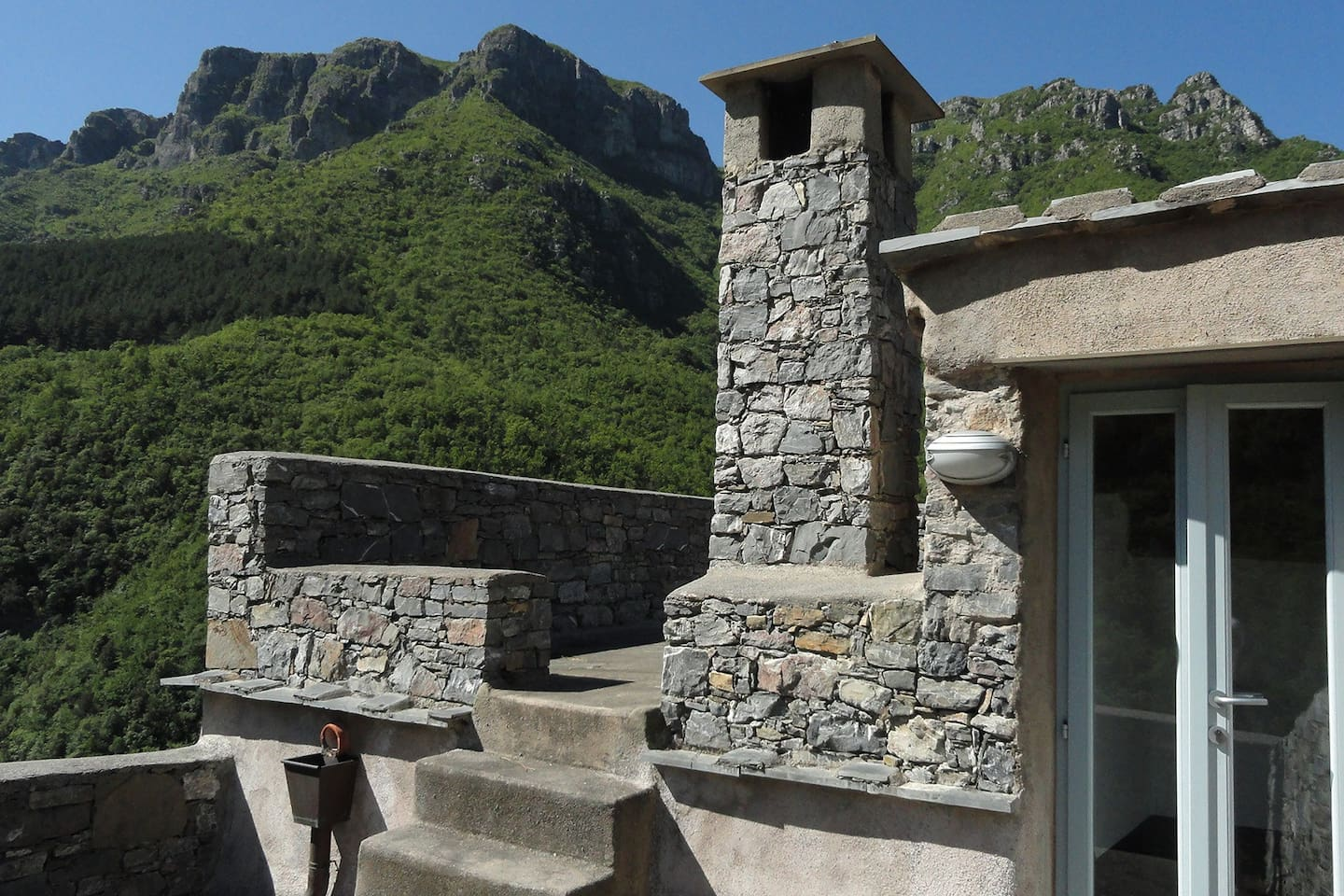 the terrace on the roof has a terrific view of the peaks crowning the village.