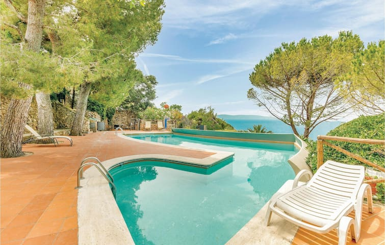 Holiday apartment with 1 bedroom on 65m² in Porto Santo Stefano GR