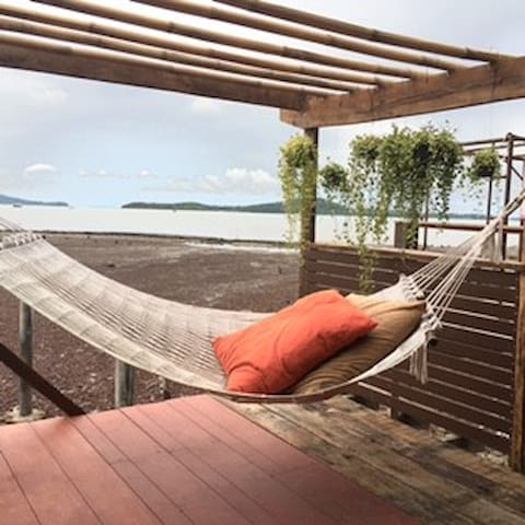 Cozy Hammock Balcony Area with main dining table to enjoy your recreation time.