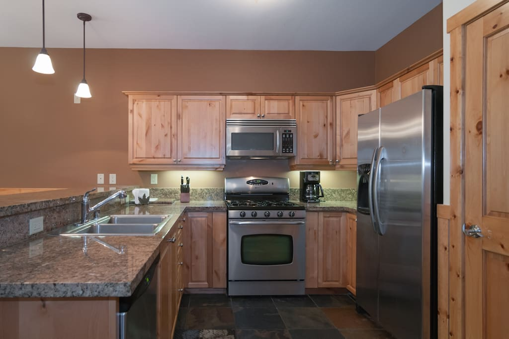Well equipped kitchen includes granite counter tops and stainless steel appliances.