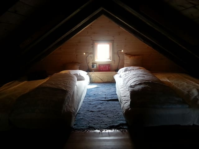 """1, 2 or 4 flatbeds .The loft has 4 separate mattresses. They are flexible to move around, and can easily be put together for a double """"flat bed' as well. The two end walls have been given isolation and new wood panel in 2016."""