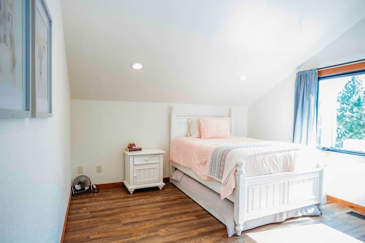 This bedroom has a full size bed with full size trundle bed.