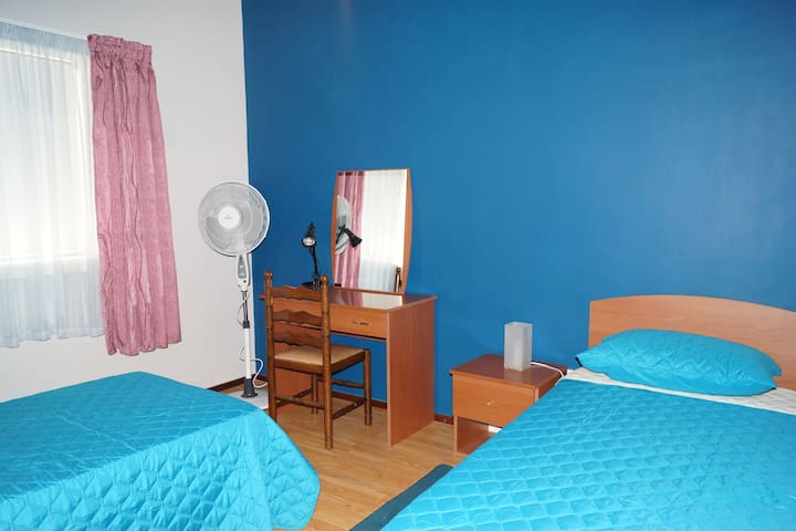 Desk to be shared in the room.  Fan available.  New mattresses and soft furnishings.