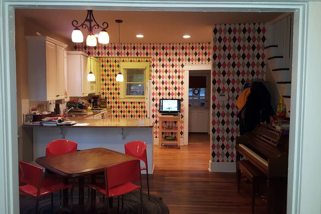 The open kitchen and dining area anchors the house + piano!