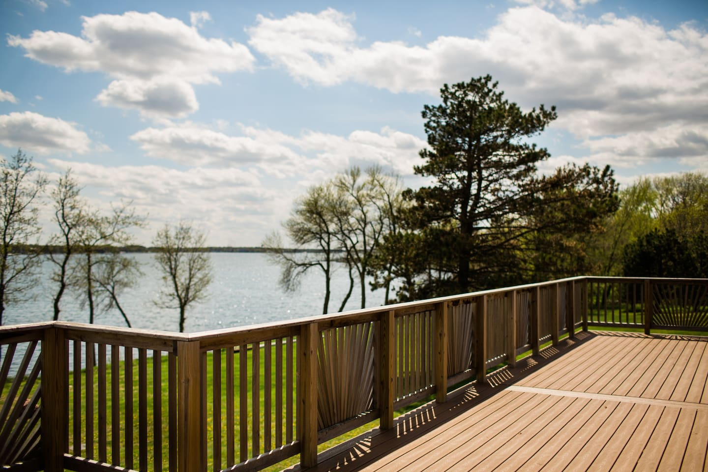 Deck and Patio with fire pit, chairs, picnic tables, and lake views.